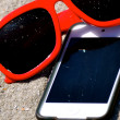 Stock Photo: In Sand - Sunglasses iPod iPhone 6
