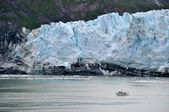 Boat glides past glaciers — Photo