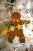 Gingerbread man with garland — Stock Photo