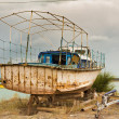 Stock Photo: Rusting boats in desert Central Asia, lake Alakol