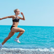 Women sport on sea - Stock Photo