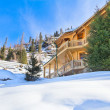 House in winter mountain - Stock Photo