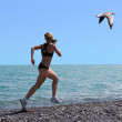 Exercising women seagull — Stock Photo