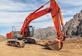 Excavator mountain construction — Stock Photo