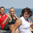 Women ok sport sea beach at summer — Stock Photo