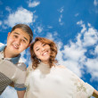 Woman men couple against blue sky   — Stock Photo