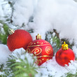 Christmas decoration on snow — Stock Photo