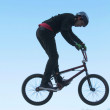 Teenagers on bicycles BMX spin — Stock Photo #41835611
