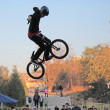 Teenagers on bicycles BMX spin — Stock Photo #41835615