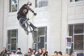 Teenagers on bicycles BMX spin — Stock Photo