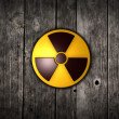 Nuclear symbol on wood — Stock Photo #20800527