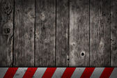 Wooden background with warning bar — Stock Photo