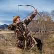 Nomad. Kazakh, hungarian warrior whith bow. Hunter. — Stock Photo