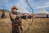 Asian warrior whith bow. Hunter. — Stock Photo