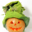 Pumpkin with green Halloween hat on - Stock Photo