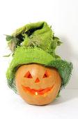 Pumpkin with green Halloween hat on — Stock Photo