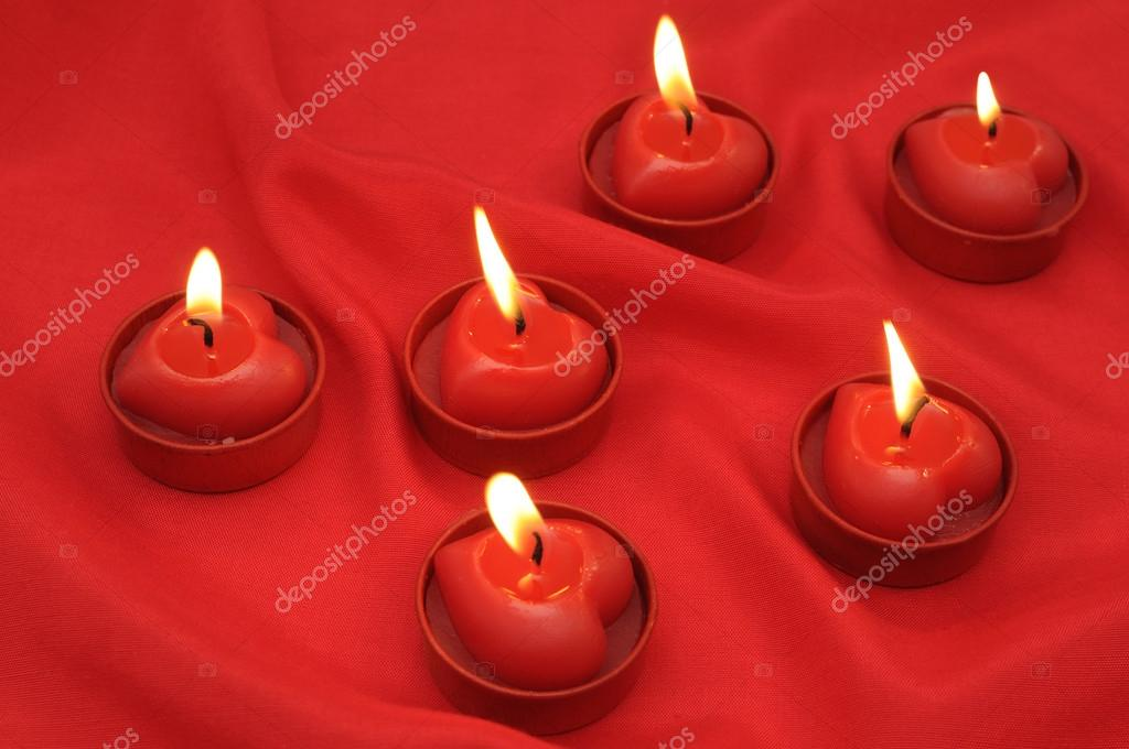 Background of red silk drape and six flaming candles — Stock Photo #13689516