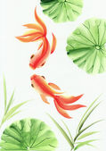 Goldfishes among the lotus leaves — Stock Photo