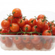 Cherry tomatoes in a plastic container — Stock Photo