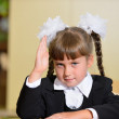 Schoolchild with a raised hand — Stock Photo