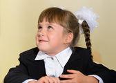 Skolbarn med vita bågar och svart svit — Stockfoto