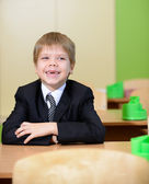 Toothless laughing schoolboy — Stock Photo
