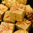 Gold box with gifts. — Stock Photo