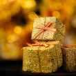 Stock Photo: Gold box with gifts.
