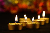 Golden burning candles — Stock Photo