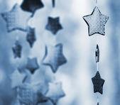 Garland of stars blue toned — Stock Photo