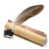 A feather pen, ink,rolls of old yellowed paper — Stock Photo