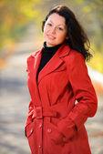 Beautiful woman in a red cloak — Stock Photo