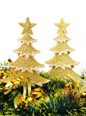 Gold decorated Christmas trees and holiday object — Stock Photo