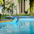A man cleans the pool - 