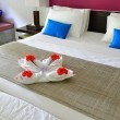 Royalty-Free Stock Photo: Room in a hotel with a decoration of the towel and flowers on th