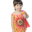 The little girl with color package — Stock Photo #3310930