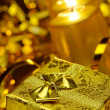 Gold christmas candles and gold gift boxes — Stockfoto #6771883