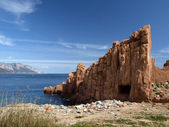 Arbatax with the known red porphyry rocks nearby the port at the Capo Bellavista, Sardinia, Italy, Europe — Stock Photo