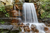 Small waterfall in a park in Georgsmarienhuette, Lower Saxony, Germany, Europe — Stock Photo