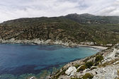 Marine de Giottani, Cap Corse, gravel beach at the west coast with a little harbor and the small hotel, Corsica, FranceMarine de Giottani, Cap Corse, gravel beach at the west coast — Stock Photo