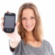 Teenager holding up a mobile phone Teenager holding up a mobile phone — Stock Photo #12453012
