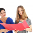 Smiling student with mother or teacher — Stock Photo #12456246