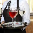 Waiter carrying wine glasses — Stock Photo