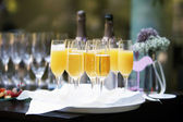 Flutes of champagne and orange juice — Stock Photo
