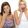 Two women reacting in shocked awe — Stock Photo