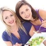 Women enjoying a healthy salad Women enjoying a healthy salad — Stock Photo #12812519