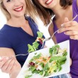 Health conscious women enjoying salad Health conscious friends enjoying sal — Foto de Stock