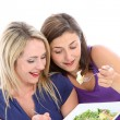 Young dieters sharing a salad — Stock Photo
