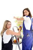 Women at work wallpapering Women at work wallpapering — Stock Photo