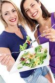 Health conscious women enjoying salad Health conscious friends enjoying sal — Stock Photo